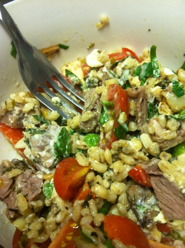 Barley with spring vegetables, lamb, and lemon yogurt sauce